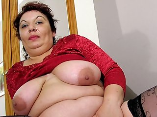 This big mama loves to please her wet pussy