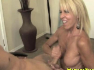 Mature blonde spoiling a young lovers dick