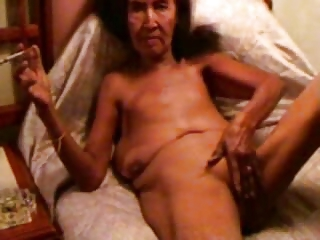 Ugly old slut rubbing pussy and smoking. Amateur older