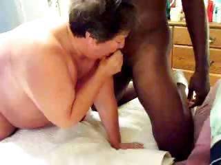 Plumper MILF mates with a black gentleman's cock doggy style