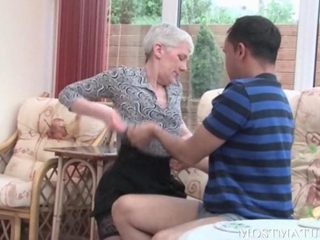 Blonde mature gets her tits teased